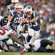 FOXBOROUGH, MASSACHUSETTS - JANUARY 14: Running back Dion Lewis #33 of the New England Patriots  in action as he is ankle tapped by cornerback Kareem Jackson #25 of the Houston Texans after making a break during the Houston Texans Vs New England Patriots Divisional round game during the NFL play-offs on January 14th, 2017 at Gillette Stadium, Foxborough, Massachusetts. (Photo by Tim Clayton/Corbis via Getty Images)