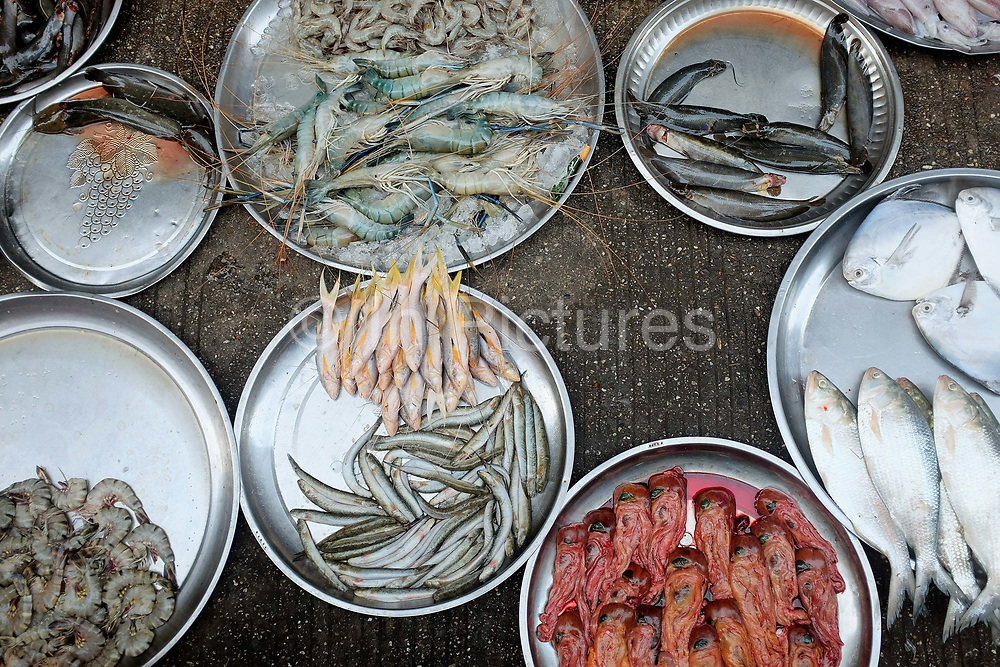 Fresh seafood for sale at an early morning street market in Yangon on 16th January 2016, Myanmar.  A large variety of local products are available for sale in fresh markets all over Yangon, all being sold on small individual stalls