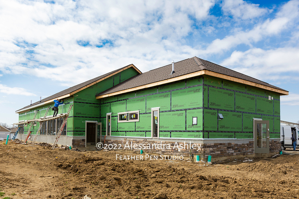 Exterior and roof work in progress at building site of new physical therapy and wellness center.