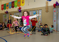 Abrie Sargent takes a big jump during the Jump for Heart event at Elm Street School Friday afternoon raising money for the American Heart Association.  (Karen Bobotas/for the Laconia Daily Sun)