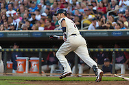 Joe Mauer #7 of the Minnesota Twins runs to 1st base against the Detroit Tigers on June 15, 2013 at Target Field in Minneapolis, Minnesota.  The Twins defeated the Tigers 6 to 3.  Photo: Ben Krause
