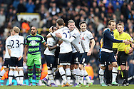 Danny Rose of Tottenham Hotspur is hugged by Kevin Wimmer of Tottenham Hotspur and Toby Alderweireld of Tottenham Hotspur as they celebrate after the final whistle. Barclays Premier league match, Tottenham Hotspur v Swansea city at White Hart Lane in London on Sunday 28th February 2016.<br /> pic by John Patrick Fletcher, Andrew Orchard sports photography.