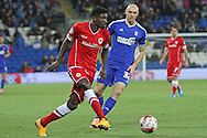 Bruno Ecuele Manga of Cardiff plays the ball back to goal, under the watch of Connor Samon of Ipswich.<br /> <br /> Skybet Football League Championship match, Cardiff City v Ipswich Town at the Cardiff city stadium in Cardiff, South Wales on Tuesday 21st October 2014<br /> pic by Mark Hawkins, Andrew Orchard sports photography.