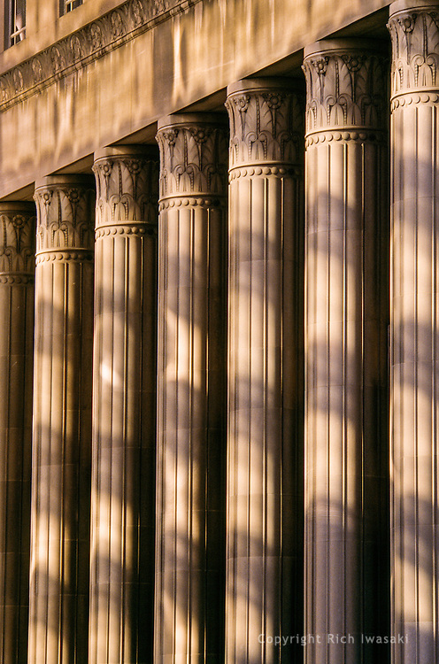 Reflected sunlight and shadows on columns of US Courthouse/Customshouse in St. Louis, Missouri