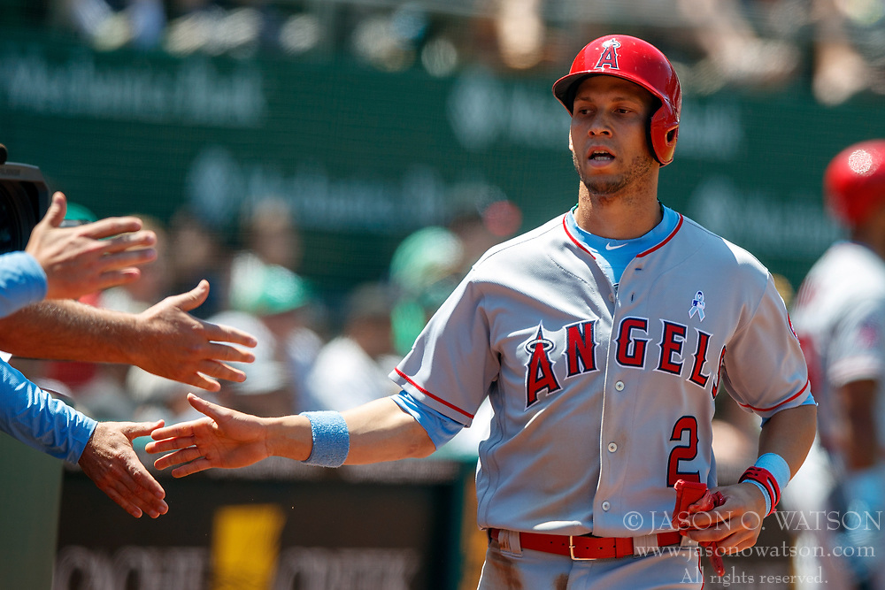 OAKLAND, CA - JUNE 17: Andrelton Simmons #2 of the Los Angeles Angels of Anaheim is congratulated by teammates after scoring a run against the Oakland Athletics during the sixth inning at the Oakland Coliseum on June 17, 2018 in Oakland, California. The Oakland Athletics defeated the Los Angeles Angels of Anaheim 6-5 in 11 innings. (Photo by Jason O. Watson/Getty Images) *** Local Caption *** Andrelton Simmons