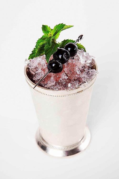 Morlacco Julep with Luxardo cherries on white .