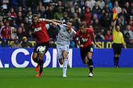 Swansea city's Michu is squeezed out by Man Utd's Rio Ferdinand (l) and Nemanja Vidic. Barclays Premier league, Swansea city v Manchester Utd in Swansea, South Wales on Saturday 17th August 2013. pic by Andrew Orchard ,Andrew Orchard sports photography,