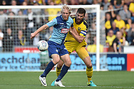 Wycombe Wanderers striker Craig Mackail-Smith (9) battles for possession  with Oxford United defender John Mousinho (15) during the EFL Sky Bet League 1 match between Wycombe Wanderers and Oxford United at Adams Park, High Wycombe, England on 15 September 2018.