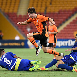 BRISBANE, AUSTRALIA - JANUARY 31: Shannon Brady of the Roar evades tackles from Dennis Villanueva and Amani Aguinaldo of Global FC during the second qualifying round of the Asian Champions League match between the Brisbane Roar and Global FC at Suncorp Stadium on January 31, 2017 in Brisbane, Australia. (Photo by Patrick Kearney/Brisbane Roar)