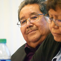 Zuni Gov. Val Panteah Sr. is seen smiling behind Lt. Gov. Birdena Sanchez during a political forum held at the Pueblo earlier this year. He was re-elected to continue running the pueblo during the Zuni general election Sunday.
