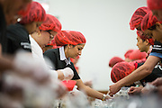 """More than 300 SanDisk employees work together to pack food during the Stop Hunger Now Foundation's """"Mayday, Mayday"""" food-packing event at SanDisk Corporation in Milpitas, California, on May 13, 2014. (Stan Olszewski/SOSKIphoto)"""