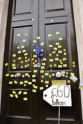 Put it to the People demonstration in central London against Brexit and an appeal for a Peoples Vote on a final Deal. Stickers on Cabinet Office entrance. London UK 23 March 2019