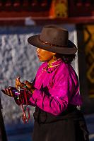 Tibetan pilgrims circumambulate through Barkhor Square and around The Barkhor, Lhasa, Tibet (Xizang), China.