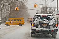 Merrick, New York, U.S. January 21, 2014. School buses are seen going slowly on snowy streets when Long Island towns declare a snow emergency and schools close early, with up to 10 inches of snow expected.