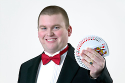 Magician performing a magic trick with a pack of cards,