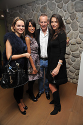 Left to right, MARIA HATZISTEFANIS, JACKIE ST.CLAIR, CARL MICHAELSON and CHARLOTTE STOCKDALE at a party to celebrate the announcement of the 20 shortlisted designers for the UK final of the Triumph Inspiration Award 2011 held at the home of Charlotte Stockdale, 8 Francis Street, London SW1 on 31st March 2011.