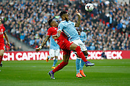 Nathaniel Clyne of Liverpool (l)  and Raheem Sterling of Manchester City tussle for the ball. Capital One Cup Final, Liverpool v Manchester City at Wembley stadium in London, England on Sunday 28th Feb 2016. pic by Chris Stading, Andrew Orchard sports photography.