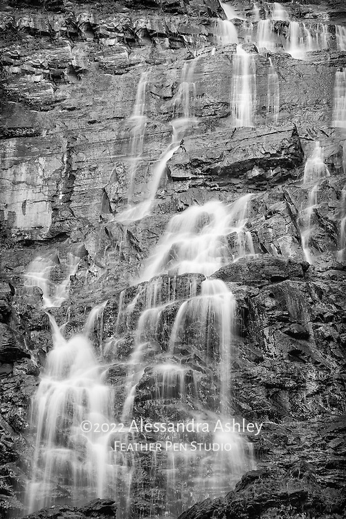 A serene section of the multiple gentle cascades of  Morrell Falls, a 90-ft. waterfall at the base of the Swan mountain range, reached via the Morrell Falls National Recreational Trail near Seeley Lake, MT.