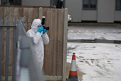 © Licensed to London News Pictures. 28/10/2020. London, UK. A forensics officer gathers evidence at the crime scene in Three Bridges, Sussex after a man has died after sustaining critical injures in an assault, on Tuesday evening. No arrests have been made. Photo credit: Marcin Nowak/LNP
