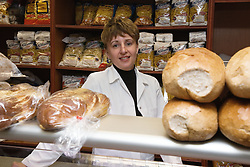 Shop Assistant serving in Polish food shop,