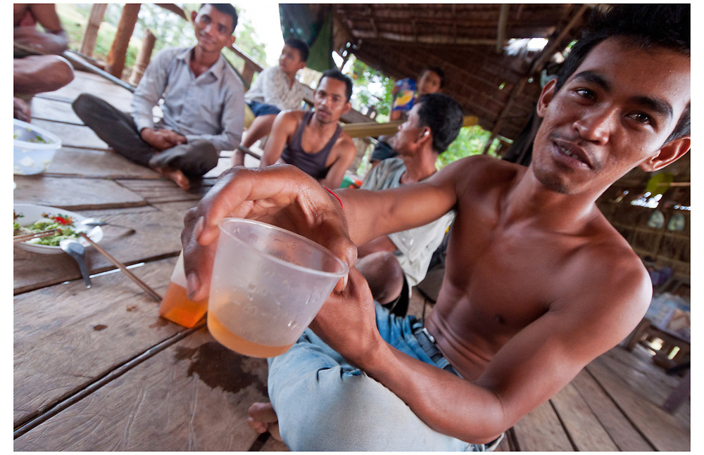 Rice wine with the locals, Kampot, Cambodia.