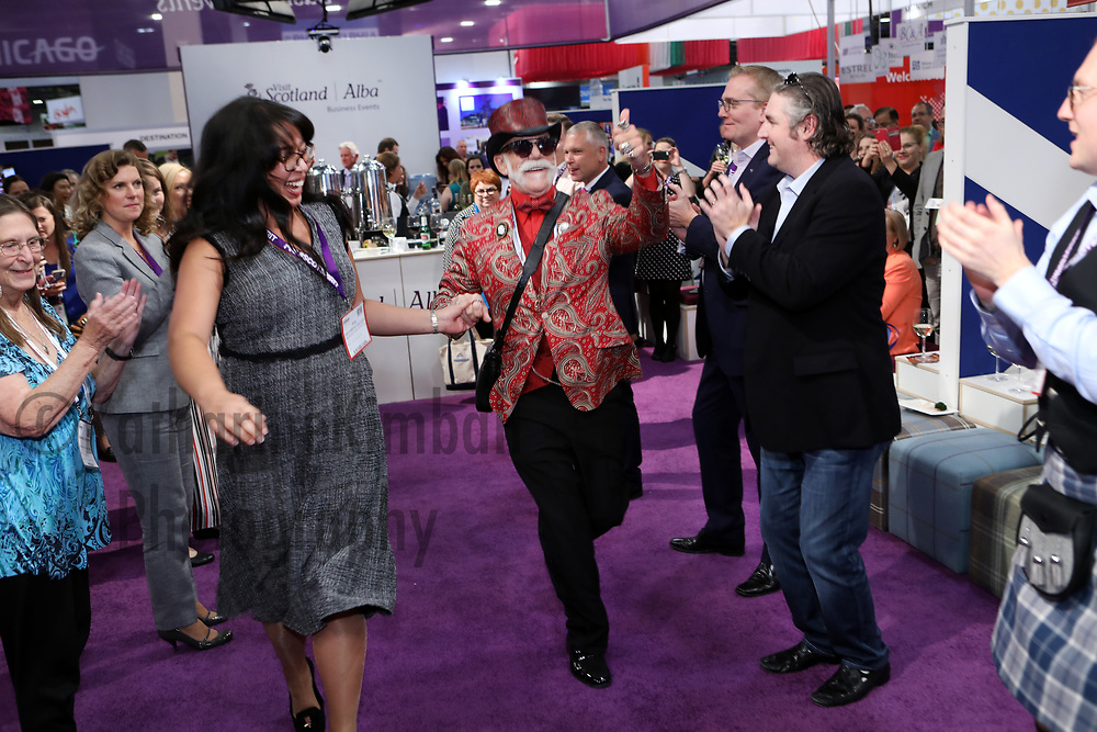 Dancing at the Visit Scotland booth at the IMEX America Expo.