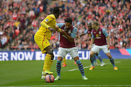 Mario Balotelli of Liverpool blocks the ball from Kieran Richardson of Aston Villa. The FA Cup, semi final match, Aston Villa v Liverpool at Wembley Stadium in London on Sunday 19th April 2015.<br /> pic by John Patrick Fletcher, Andrew Orchard sports photography.
