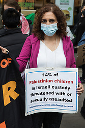 London, UK. 11th May, 2021. Activists from Palestine Action protest outside the UK headquarters of Elbit Systems, an Israel-based company developing technologies used for military applications including drones, precision guidance, surveillance and intruder-detection systems. The activists were protesting against the company's presence in the UK and in solidarity with the Palestinian people following attempts at forced evictions of Palestinian families in the Sheikh Jarrah neighbourhood of East Jerusalem, the deployment of Israeli forces against worshippers at the Al-Aqsa mosque during Ramadan and air strikes on Gaza which have killed several children.