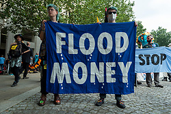 """© Licensed to London News Pictures. 03/09/2021. LONDON, UK.  Climate activists from Extinction Rebellion with a banner ahead of a protest march from St Paul's Cathedral to the Lloyds Building in the City of London to highlight the complicity of the financial industry on climate change.  The event takes place on day twelve of the two week 'Impossible Rebellion' protest to """"target the root cause of the climate and ecological crisis"""".  Photo credit: Stephen Chung/LNP"""
