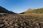 The rocky shoreline of Loch Leven, at its head, just outside Kinlochleven at low tide.