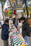 People playing chess along South Michigan Avenue in Chicago, IL.