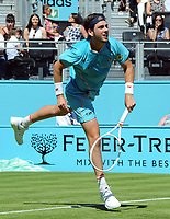 Tennis - 2018 Queen's Club Fever-Tree Championships - Day One, Monday<br /> <br /> Men's Singles, First Round: Stan Wawrinka (SUI) vs. Cameron Norrie (GBR)<br /> <br /> Norrie serves, on Centre Court.<br /> <br /> COLORSPORT/ANDREW COWIE