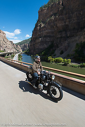 Alan Stulberg of Revival Cycles (Austin) riding Bryan Bossier's 1933 Brough Superior 11-50 on Interstate 70 in Glenwood Canyon beside the Colorado River during Stage 10 (278 miles) of the Motorcycle Cannonball Cross-Country Endurance Run, which on this day ran from Golden to Grand Junction, CO., USA. Monday, September 15, 2014.  Photography ©2014 Michael Lichter.