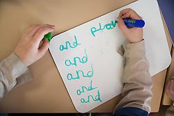 Child practising writing skills,