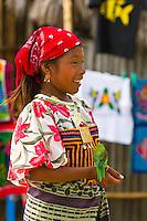 Kuna Indian girl in native costume holding parakeet, Wichub Wala Island, San Blas Islands (Kuna Yala), Caribbean Sea, Panama