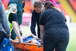 Dundee United's manager Robbie Neilson as injured Inverness Caledonian Thistle's Brad McKay passes. Dundee United 4 v 1 Inverness Caledonian Thistle, first Scottish Championship game of season 2019-2020, played 3/8/2019 at Tannadice Park, Dundee.