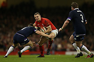 Hadleigh Parkes of Wales is stopped by Gordon Reid of Scotland. Wales v Scotland, NatWest 6 nations 2018 championship match at the Principality Stadium in Cardiff , South Wales on Saturday 3rd February 2018.<br /> pic by Andrew Orchard, Andrew Orchard sports photography