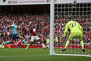 Danny Welbeck of Arsenal shoots and scores Arsenal's 3rd goal.  Premier league match, Arsenal v AFC Bournemouth at the Emirates Stadium in London on Saturday 9th September 2017. pic by Kieran Clarke, Andrew Orchard sports photography.