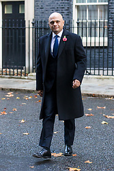 © Licensed to London News Pictures. 10/11/2019. London, UK. Chancellor of the Exchequer Sajid Javid walks through Downing Street to attend the Remembrance Sunday Ceremony at the Cenotaph in Whitehall. Remembrance Sunday events are held across the country today as the UK remembers and honours those who have sacrificed themselves in two world wars and other conflicts. Photo credit: Vickie Flores/LNP