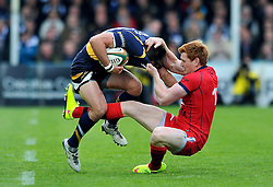 Jack Tovey of Bristol Rugby tackles Alex Grove of Worcester Warriors - Photo mandatory by-line: Patrick Khachfe/JMP - Mobile: 07966 386802 27/05/2015 - SPORT - RUGBY UNION - Worcester - Sixways Stadium - Worcester Warriors v Bristol Rugby - Greene King IPA Championship Play-off Final (Second leg)