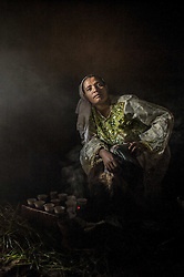 Children watch as Ramla Sharif roasts coffee inside her home in the village of Choche in Ethiopia. Legend has it this is the birthplace of coffee. The region is home to the largest pool of genetic diversity in the world of coffee. It is home to more genetic diversity in coffee than the rest of the producing countries combined by a huge margin.