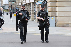 Armed police in the centre of Manchester ahead of a benefit concert for the Manchester bombing victims, as police said it will still take place but security will be stepped up following the London attack.