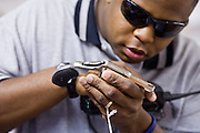 June 28, 2008 - PHOENIX, AZ: Phoenix police officer TIM GRAHAM checks the make and model of a revolver turned in during the gun buy back Saturday. The city of Phoenix conducted its first gun buy back program Saturday. People who turned in a functioning gun of any sort were given a card good for $100 worth of groceries at Basha's or Food City grocery stores in the Phoenix area. The program was funded by a donation of $10,000 worth of cards. All of the cards were given away within hours of the start of the program. Critics said the buy back was a sham, that only old, barely serviceable firearms would be turned in. Most of the guns turned in did appear to be old, but all were functioning. Photo by Jack Kurtz / ZUMA Press