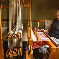 D.D. Woodbury laughs while working on one of her many weaving looms at her home in Clear Lake, 10/18/02.