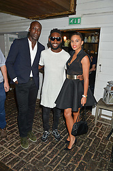 Left to right, OZWALD BOATENG, TINIE TEMPAH and LOUISE HAZEL at the Warner Music Group Summer Party in association with British GQ held at Shoreditch House, Ebor Street, London E2 on 8th July 2015.
