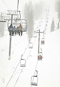 SHOT 2/12/12 3:55:04 PM - Skiers ride chair lifts as heavy snow falls at Monarch Ski and Snowboard Area. Monarch is located on U.S. Highway 50. It is twenty miles west of Salida, Colorado, on Monarch Pass and has 54 trails, two terrain parks, and a newly-opened Extreme-Terrain area called Mirkwood. Monarch fist opened in 1939 with one rope tow running up the infamous Gunbarrel run, a long, steep, heavily moguled run..(Photo by Marc Piscotty / © 2012)