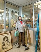 Italy, Capannori, MIchele Granucci warehouseman testing household appliances