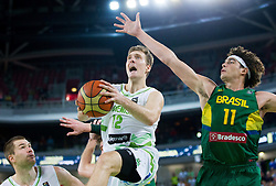 Zoran Dragic of Slovenia vs Anderson Varejao of Brasil during friendly basketball match between National Teams of Slovenia and Brasil at Day 2 of Telemach Tournament on August 22, 2014 in Arena Stozice, Ljubljana, Slovenia. Photo by Vid Ponikvar / Sportida