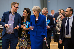 Maidenhead, UK. 13 December, 2019. Former Conservative Prime Minister Theresa May observes proceedings at the count for the general election for the Maidenhead constituency.