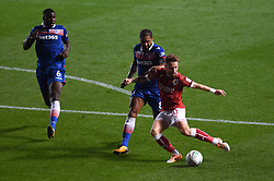 Bristol City's Matt Taylor and Stoke City's Glen Johnson battle for the ball during the Carabao Cup, third round match at Ashton Gate Stadium, Bristol.